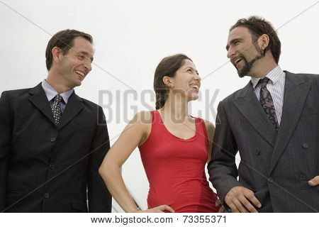 Multi-ethnic businesspeople laughing