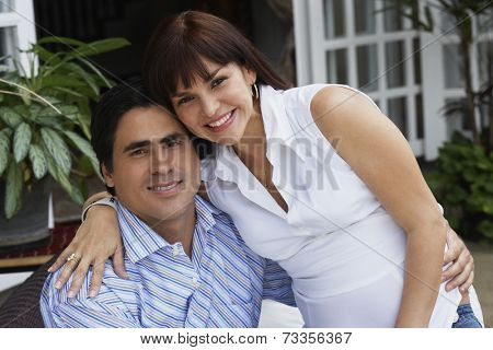 Hispanic couple hugging