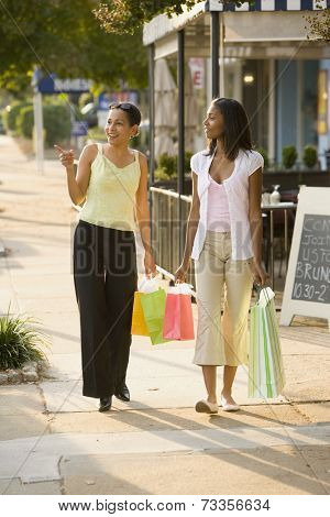 African mother and daughter carrying shopping bags