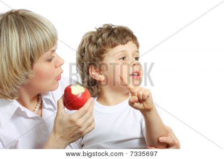 Woman And Boy Eating Apple