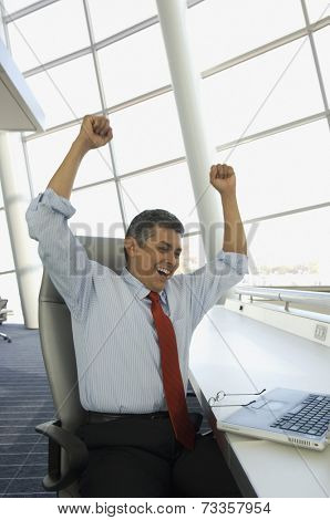 Hispanic businessman cheering