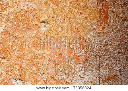Concrete Surface With The Remains Of Orange Paint And Whitewash