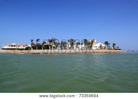 View of houses and hotels from boat floating on channels of El Gouna - Egypt
