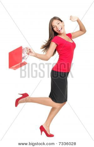 Shopping Woman In Joy Running Holding Bag