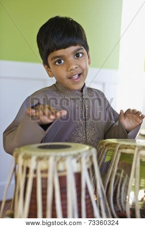 Indian boy playing drums