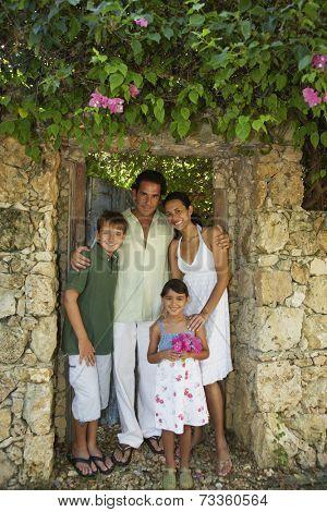 Hispanic family in garden doorway