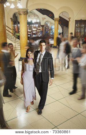 Young Hispanic couple in evening wear