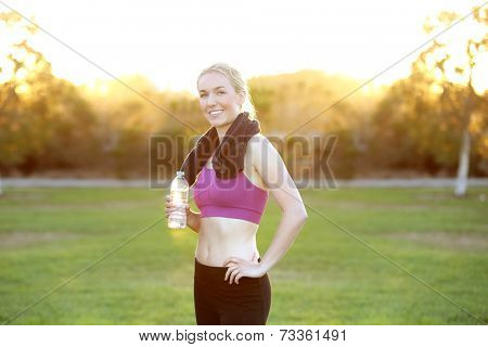 Young fit woman after exercising at a park