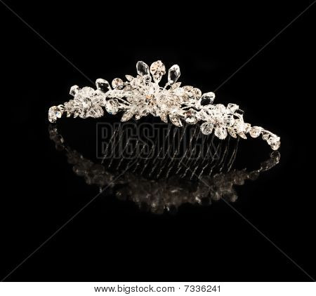Diamond Comb For Hair On A Black Background With Reflexion