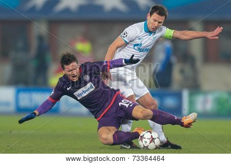 VIENNA, AUSTRIA - DEZEMBER 11 Konstantin Zyryanov (#18 Zenit) and Marko Stankovic (#19 Austria) fight for the ball at a UEFA Champions League game on Dezember 11, 2013 in Vienna, Austria.