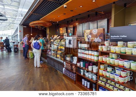 DUSSELDORF - SEP 16:Starbucks cafe interior in airport on September 16, 2014 in Dusseldorf, Germany. International airport of Dusseldorf located approximately 7 kilometres north of downtown Dusseldorf