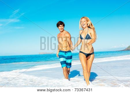 Happy Good Looking Couple Having Fun on Beautiful Sunny Beach