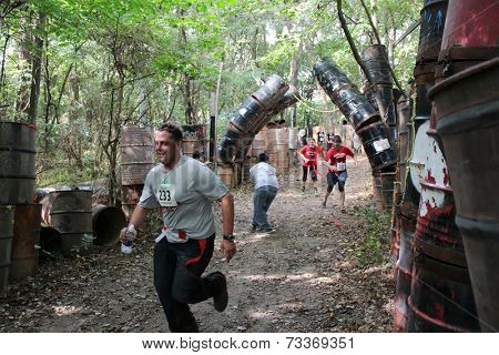 MUSKOGEE, OK - Sept. 13: Runners pass in a zombie-infested alley during the Castle Zombie Run at the Castle of Muskogee in Muskogee, OK on September 13, 2014.