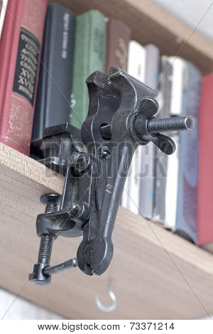 Black Homemade Vise On Bookshelf