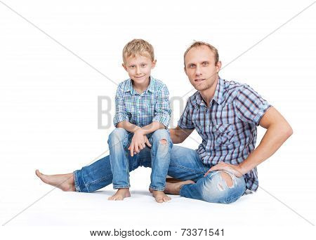 Father With Son In Old Tattered Jeans And Plaid Shirts On The White