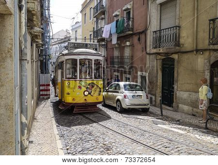 Tram, The Symbol Of The City In Narrow Street Of Lisbon.