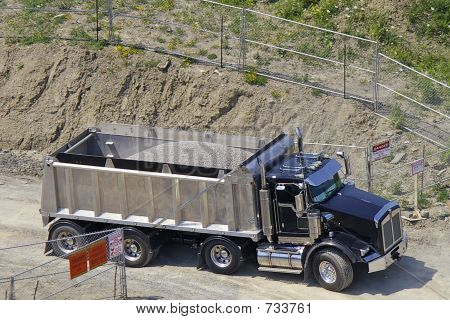 Dump Truck Backing In To Construction Site