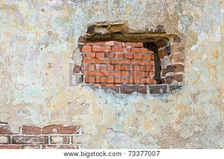 The Plastered Wall With A Hole