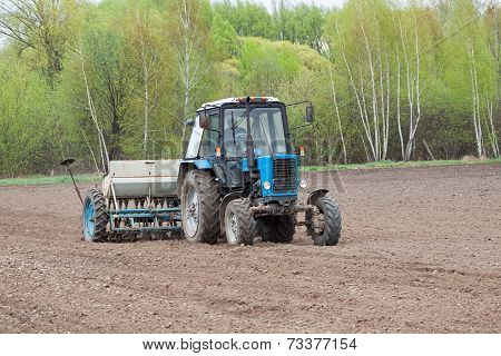 Tractor Seeding The Field