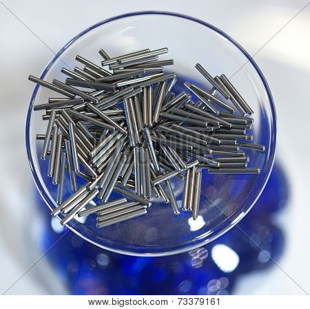 Metal pins in a glass bowl