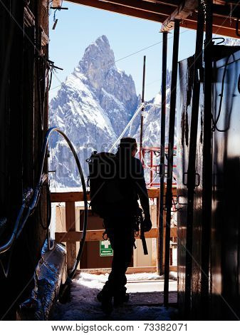 Mountaineer in a alpine hut. In background Aiguille Noire, Mont Blanc, Italy.