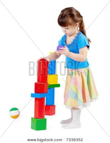 Girl Build A Tower Of Toy Bricks
