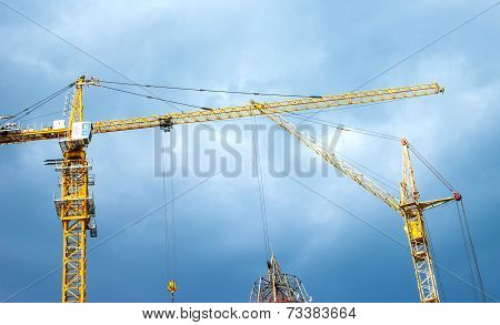 Two Working Cranes