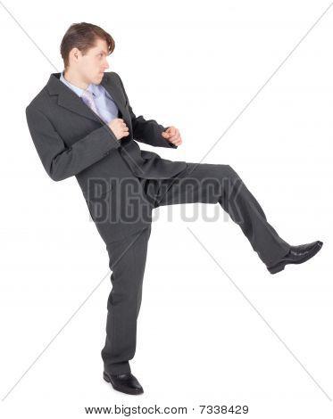 Young Businessman Kicks As Karate