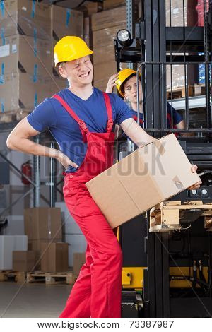 Man With A Backache In Factory