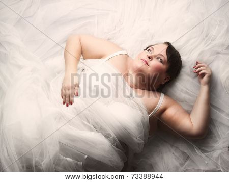 Woman And White Tulle Fabric
