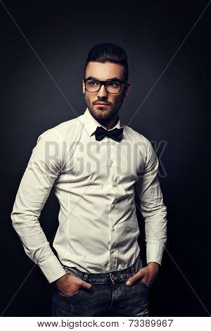 Handsome Man With Eyeglasses Posing In Studio On Dark Background
