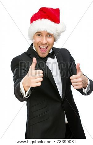 Half-length portrait of businessman wearing Santa Claus cap who thumbs up, isolated on white. Concept of holidays and Christmas