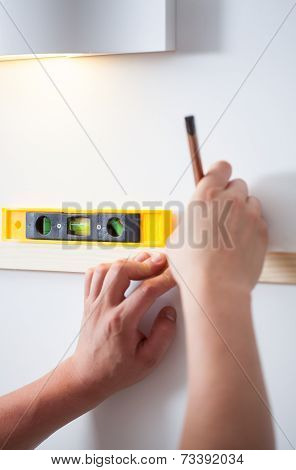 Handyman's Hands With Spirit Level