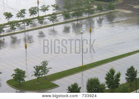 Empty wet parking lot in summer