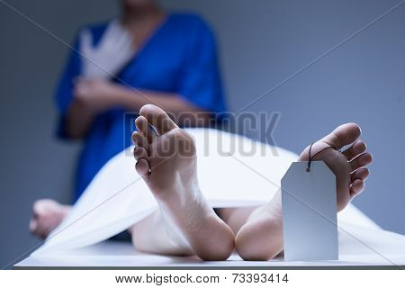 Worker Of Morgue During Job