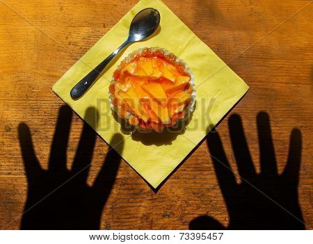 Hands reaching for dessert