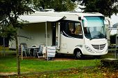 stock photo of trailer park  - Caravan with a awning at a camp site - JPG