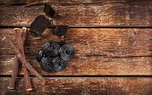 stock photo of licorice  - Production steps of licorice roots pure blocks and candy on wooden table - JPG