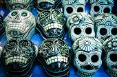 pic of day dead skull  - Traditional mexican day of the dead souvenir ceramic skulls at market stall - JPG