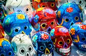 stock photo of day dead skull  - Traditional mexican day of the dead souvenir ceramic skulls at market stall - JPG