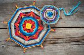 image of tibetan  - Two knitted tibetan mandala from threads top view - JPG