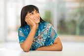 stock photo of sari  - beautiful asian woman in sari looking up - JPG