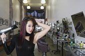foto of hair blowing  - Asian hair stylist blow drying hair - JPG