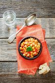 foto of pangasius  - chickpeas with vegetables and pangasius on a dark wood background - JPG