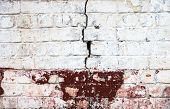 picture of mortar-joint  - The old cracked whitewashed brick wall with rich texture - JPG
