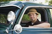 picture of 35 to 40 year olds  - Hispanic man sitting in truck - JPG