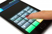 picture of dial pad  - Woman is dialing on mobile touchscreen phone - JPG