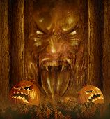 stock photo of scary haunted  - Halloween ghost concept as a creepy scary phantom appearing through a dark haunted forest with jack o lantern pumpkins on an autumn night  - JPG
