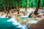 pic of amaze  - Jangle landscape with amazing turquoise water of Kuang Si cascade waterfall at deep tropical rain forest - JPG