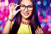 stock photo of flirty  - Glamorous girl in glasses - JPG
